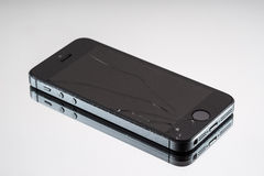 Photo of a broken iPhone 5. A smartphone developed by Apple Inc. Photo taken on: OCTOBER 6, 2014 stock photos