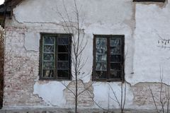 Broken Windows to the abandoned House stock photo