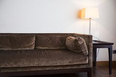 Brown sofa and lamp in the living room. Photo of brown sofa and lamp in the living room Royalty Free Stock Photo