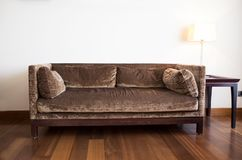 Brown sofa and lamp in the living room. Photo of brown sofa and lamp in the living room Stock Photography