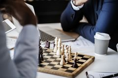 Photo of Brown Wooden Chess Set on Table Beside White and Gray Disposable Cup royalty free stock photos