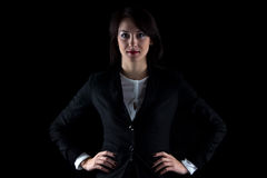 Photo brunette business woman with hands on hips Stock Photo
