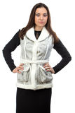 Photo of the brunette in fake fur waistcoat Royalty Free Stock Photography