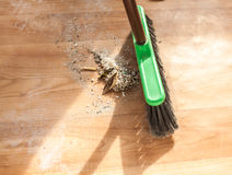 Photo of brush cleaning pile of debris Stock Photo