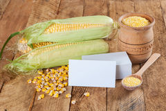Photo of business cards with corn Stock Photo