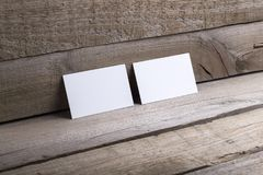 Business cards isolated on old wood background Stock Image