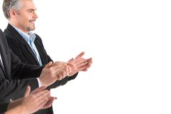 Photo of business people applauding at white background. Royalty Free Stock Images