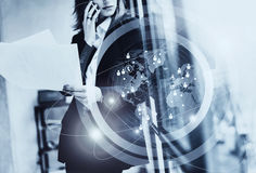 Photo business woman wearing black suit,talking smartphone, holding papers hands.Open space loft office.Panoramic Royalty Free Stock Photos