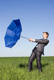 Photo of businessman flying on his umbrella Stock Photos