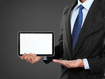 Photo of a businessman showing blank tablet PC monitor Stock Photo