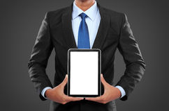 Photo of a businessman showing blank tablet PC monitor stock images