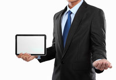 Photo of a businessman showing blank tablet PC monitor stock photos