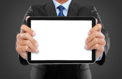 Photo of a businessman showing blank tablet PC monitor royalty free stock image