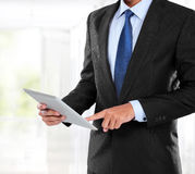 Photo of a businessman using tablet PC Stock Images