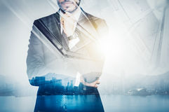 Photo of businessman wearing suit and thinking Stock Photo