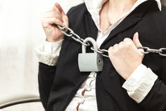 Photo of businesswoman being locked by chain and padlock Royalty Free Stock Photography
