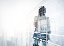 Photo of businesswoman. Double exposure, city on the background. Blurred background, horizontal. Photo of businesswoman. Double exposure, city on the background Royalty Free Stock Image