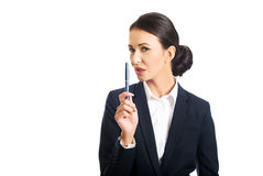 Photo of businesswoman pointing by a pen Royalty Free Stock Photos