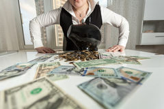 Photo of businesswoman sitting behind table with piggy bank Royalty Free Stock Photo