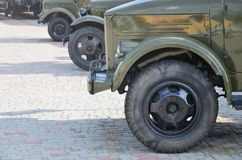 Photo of the cabins of three military off-road vehicles from the times of the Soviet Union. Side view of military cars from the f. Ront wheel stock photo