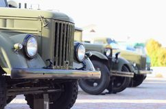 Photo of the cabins of three military off-road vehicles from the times of the Soviet Union. Side view of military cars from the f. Ront wheel royalty free stock photography