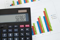 Photo of calculator and growth charts Royalty Free Stock Photos