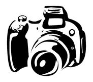 Photo camera. In black Royalty Free Stock Photography