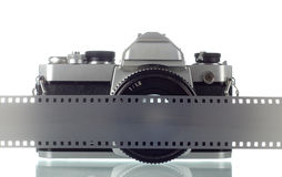 Photo camera. 35 mm film camera with negative strip Stock Photos