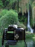 Photo camera. Shooting the waterfall royalty free stock photo