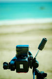 Photo camera on the beach Royalty Free Stock Photos