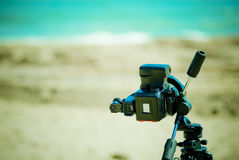 Photo camera on the beach. Old photo medium format camera with beach and sea in the background Stock Photo