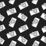 Photo camera black seamless pattern. Seamless pattern with a retro film camera on a black background. Decor for textiles, wrapping paper, scrapbooking. Flat Stock Photos