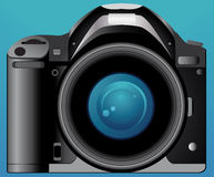 Photo camera on blue background Royalty Free Stock Image