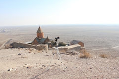 Photo camera with church background stock photos