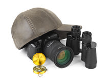 Photo camera, compass, binoculars and cap Stock Photography