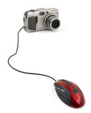 Photo camera and computer mouse Royalty Free Stock Photography