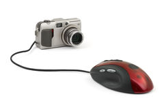 Photo camera and computer mouse Royalty Free Stock Photo