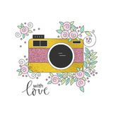 Photo camera decorated with flowers Royalty Free Stock Photos