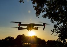 Drone Flying in the Sunset Stock Photo