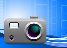 Photo camera on film background Royalty Free Stock Photo