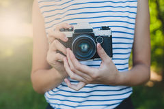 Photo camera in the girl`s hands Royalty Free Stock Image