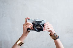 Photo camera on the gray wall background Stock Photography