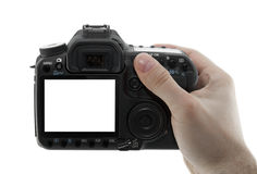 Photo camera in hand. With clipping path Royalty Free Stock Photo