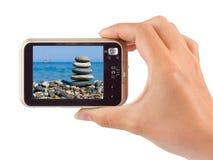 Photo camera in hand Stock Image