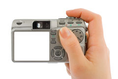 Photo camera in hand Stock Image