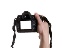 Photo camera in hand. Isolated on white background royalty free stock image
