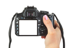 Photo camera in hand royalty free stock photography