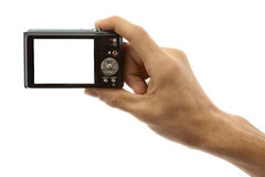 Photo camera in hand isolated on white background. Hand of a man holding a digital camera on a white background stock photo