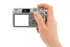Photo camera in hand Stock Images