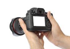Photo camera in hand Stock Photos